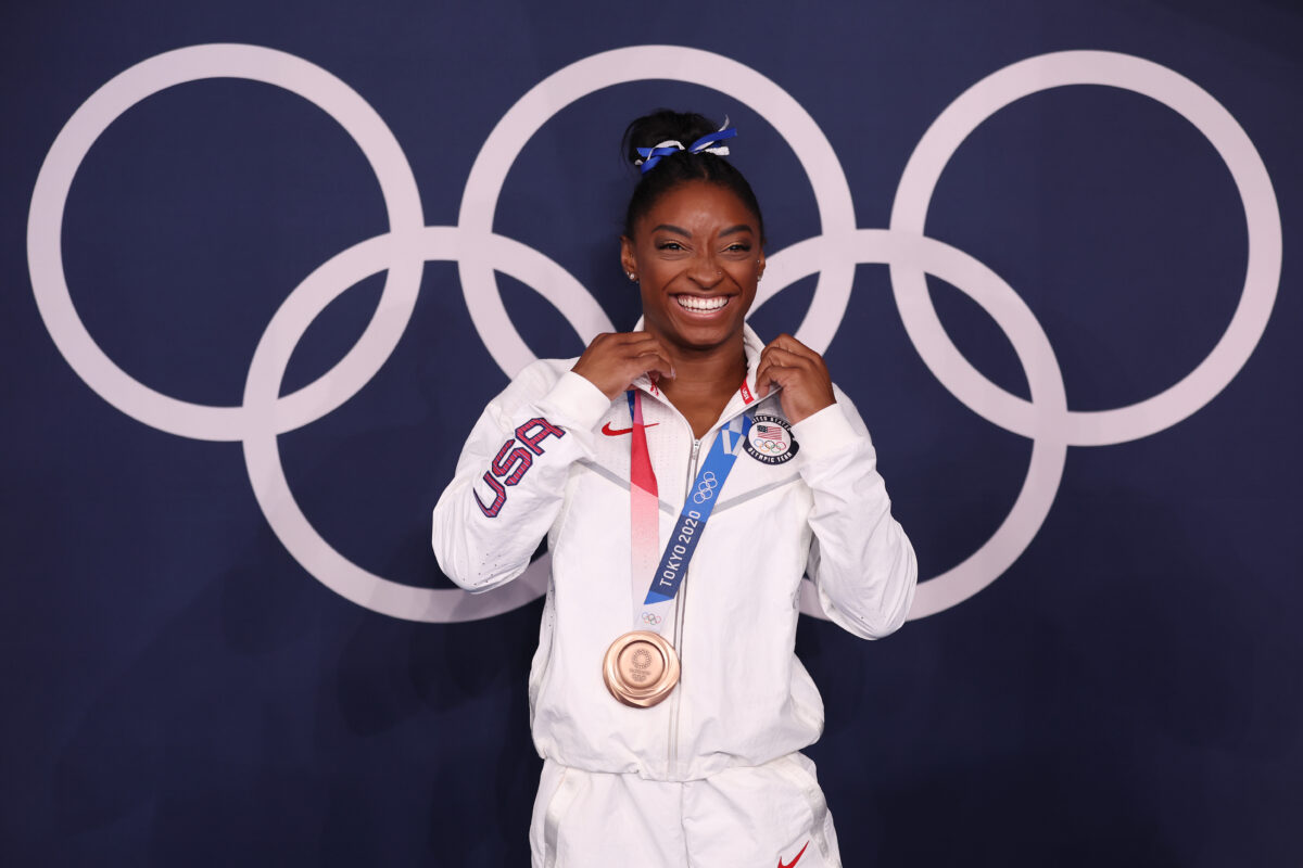 Biles wins beam bronze, her seventh medal on emotional return