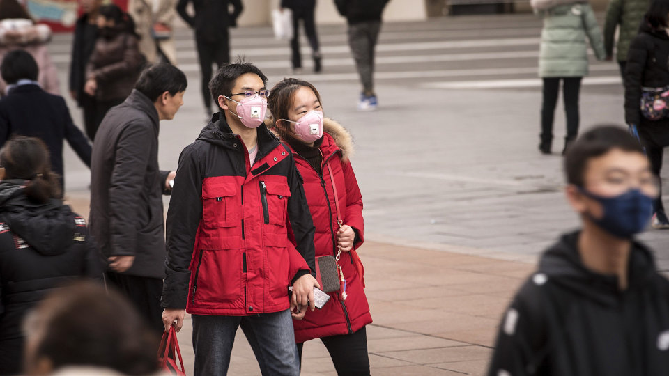 China restricts overseas travel to curb coronavirus cases